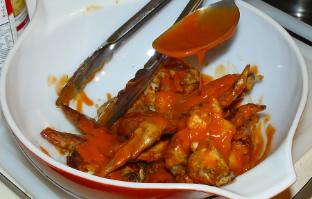 Coat Chicken Wings in Buffalo Sauce